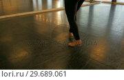 Купить «Woman practicing a tap dance», видеоролик № 29689061, снято 1 сентября 2016 г. (c) Wavebreak Media / Фотобанк Лори
