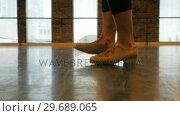 Купить «Woman practicing a tap dance», видеоролик № 29689065, снято 1 сентября 2016 г. (c) Wavebreak Media / Фотобанк Лори