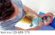 Купить «Male paramedic during cardiopulmonary resuscitation», видеоролик № 29689173, снято 25 августа 2016 г. (c) Wavebreak Media / Фотобанк Лори