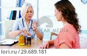 Купить «Female doctor explaining medicine to his patient», видеоролик № 29689181, снято 25 августа 2016 г. (c) Wavebreak Media / Фотобанк Лори