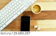 Купить «Keyboard with mobile phone and cup of coffee», видеоролик № 29689297, снято 8 июня 2016 г. (c) Wavebreak Media / Фотобанк Лори