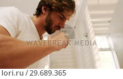 Купить «Man brushing his teeth in bathroom», видеоролик № 29689365, снято 26 августа 2016 г. (c) Wavebreak Media / Фотобанк Лори