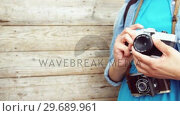 Купить «Mid section of photographer adjusting camera lens», видеоролик № 29689961, снято 1 сентября 2016 г. (c) Wavebreak Media / Фотобанк Лори