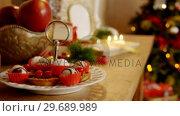 Купить «Various christmas desserts on wooden table», видеоролик № 29689989, снято 31 августа 2016 г. (c) Wavebreak Media / Фотобанк Лори