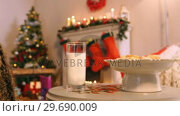 Купить «Christmas cookies on plate with a glass of milk», видеоролик № 29690009, снято 31 августа 2016 г. (c) Wavebreak Media / Фотобанк Лори