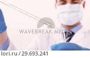 Купить «Lab technician checking sample in tube», видеоролик № 29693241, снято 18 августа 2018 г. (c) Wavebreak Media / Фотобанк Лори