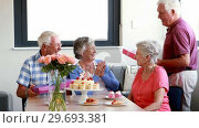 Купить «Senior woman receiving gift from her friend», видеоролик № 29693381, снято 27 апреля 2016 г. (c) Wavebreak Media / Фотобанк Лори