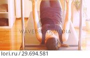Купить «Woman exercising on gym equipment», видеоролик № 29694581, снято 11 сентября 2016 г. (c) Wavebreak Media / Фотобанк Лори