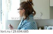 Купить «Beautiful woman having breakfast», видеоролик № 29694685, снято 4 октября 2016 г. (c) Wavebreak Media / Фотобанк Лори