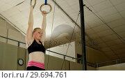 Купить «Gymnast practicing with ring row», видеоролик № 29694761, снято 14 сентября 2016 г. (c) Wavebreak Media / Фотобанк Лори