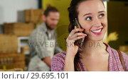 Купить «Woman talking on mobile phone at bakery section», видеоролик № 29695101, снято 4 октября 2016 г. (c) Wavebreak Media / Фотобанк Лори