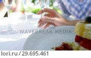 Купить «Plates of desserts on the table during lunch», видеоролик № 29695461, снято 21 ноября 2016 г. (c) Wavebreak Media / Фотобанк Лори