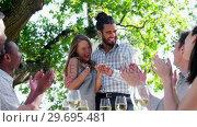 Купить «Happy couple embracing while friends applauding during lunch», видеоролик № 29695481, снято 21 ноября 2016 г. (c) Wavebreak Media / Фотобанк Лори