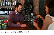 Купить «Barman interacting with female costumer while serving cocktail», видеоролик № 29695737, снято 14 ноября 2016 г. (c) Wavebreak Media / Фотобанк Лори