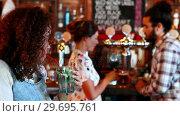 Купить «Beautiful woman looking at couple while having cocktail», видеоролик № 29695761, снято 14 ноября 2016 г. (c) Wavebreak Media / Фотобанк Лори