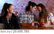Купить «Jealous woman looking at couple flirting with each other», видеоролик № 29695785, снято 14 ноября 2016 г. (c) Wavebreak Media / Фотобанк Лори