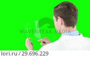 Купить «Doctor using futuristic tablet», видеоролик № 29696229, снято 18 августа 2016 г. (c) Wavebreak Media / Фотобанк Лори