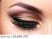 Купить «Closeup of beautiful woman eye with fashion makeup», фото № 29696797, снято 12 мая 2015 г. (c) Людмила Дутко / Фотобанк Лори