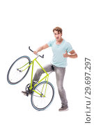 Купить «Young man with cycle isolated on white», фото № 29697297, снято 30 августа 2018 г. (c) Elnur / Фотобанк Лори