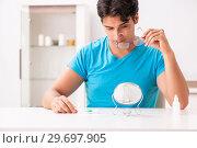 Купить «Man trying contact lenses at home», фото № 29697905, снято 6 августа 2018 г. (c) Elnur / Фотобанк Лори