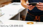 Купить «Hand of customer making payment through smartwatch», видеоролик № 29699033, снято 17 января 2017 г. (c) Wavebreak Media / Фотобанк Лори