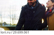 Купить «Couple talking while charging the electric car on a winter day», видеоролик № 29699061, снято 30 ноября 2016 г. (c) Wavebreak Media / Фотобанк Лори