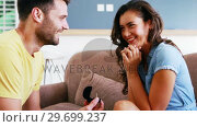 Man offering a engagement ring to woman in the living room. Стоковое видео, агентство Wavebreak Media / Фотобанк Лори