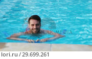 Купить «Man swimming with inflatable tube in the pool», видеоролик № 29699261, снято 29 ноября 2016 г. (c) Wavebreak Media / Фотобанк Лори