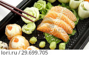 Купить «Tray of assorted sushi», видеоролик № 29699705, снято 8 декабря 2016 г. (c) Wavebreak Media / Фотобанк Лори