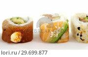 Uramaki sushi roll on white background. Стоковое видео, агентство Wavebreak Media / Фотобанк Лори