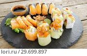 Купить «Close-up of various sushi on tray with sauce», видеоролик № 29699897, снято 8 декабря 2016 г. (c) Wavebreak Media / Фотобанк Лори