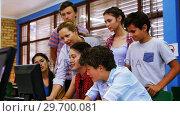 Купить «Teacher assisting students in computer class», видеоролик № 29700081, снято 20 ноября 2016 г. (c) Wavebreak Media / Фотобанк Лори