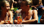 Smiling womens drinking cocktails and having fun in swimming pool. Стоковое видео, агентство Wavebreak Media / Фотобанк Лори