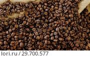 Купить «Roasted coffee beans on sack textile», видеоролик № 29700577, снято 6 октября 2016 г. (c) Wavebreak Media / Фотобанк Лори