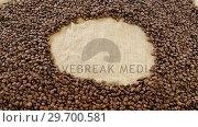 Купить «Coffee beans forming circle», видеоролик № 29700581, снято 6 октября 2016 г. (c) Wavebreak Media / Фотобанк Лори