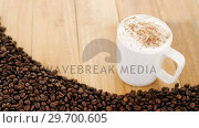 Cup of coffee with roasted beans. Стоковое видео, агентство Wavebreak Media / Фотобанк Лори