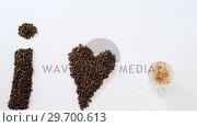 Купить «Coffee beans forming shape I love coffee», видеоролик № 29700613, снято 6 октября 2016 г. (c) Wavebreak Media / Фотобанк Лори
