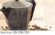 Купить «Coffee beans with metallic coffeemaker», видеоролик № 29700701, снято 6 октября 2016 г. (c) Wavebreak Media / Фотобанк Лори