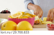 Купить «Woman cutting pineapple on chopping board», видеоролик № 29700833, снято 19 декабря 2016 г. (c) Wavebreak Media / Фотобанк Лори