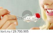 Купить «Woman eating fruit salad in bowl», видеоролик № 29700905, снято 19 декабря 2016 г. (c) Wavebreak Media / Фотобанк Лори