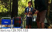 Купить «Father and son interacting with each other outside tent», видеоролик № 29701133, снято 2 марта 2017 г. (c) Wavebreak Media / Фотобанк Лори