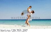 Купить «Couple enjoying together at beach», видеоролик № 29701297, снято 17 января 2017 г. (c) Wavebreak Media / Фотобанк Лори