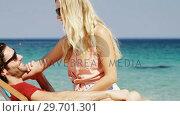 Купить «Couple enjoying together at beach», видеоролик № 29701301, снято 17 января 2017 г. (c) Wavebreak Media / Фотобанк Лори