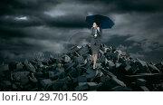 Купить «Businesswoman with umbrella standing on debris rocks during storm», видеоролик № 29701505, снято 30 мая 2017 г. (c) Wavebreak Media / Фотобанк Лори