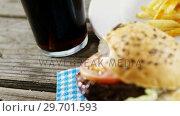 Купить «Snacks and cold drink on wooden table», видеоролик № 29701593, снято 13 января 2017 г. (c) Wavebreak Media / Фотобанк Лори