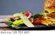 Купить «Snacks and salad on slate board», видеоролик № 29701601, снято 13 января 2017 г. (c) Wavebreak Media / Фотобанк Лори