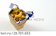French fried chips in a take away container. Стоковое видео, агентство Wavebreak Media / Фотобанк Лори