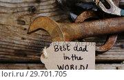 Купить «Happy fathers day card with old work tools on wooden plank», видеоролик № 29701705, снято 13 января 2017 г. (c) Wavebreak Media / Фотобанк Лори