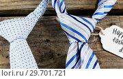 Купить «Ties arranged with happy fathers day tag on wooden plank», видеоролик № 29701721, снято 13 января 2017 г. (c) Wavebreak Media / Фотобанк Лори