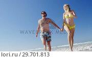 Купить «Couple having fun together at beach», видеоролик № 29701813, снято 1 марта 2017 г. (c) Wavebreak Media / Фотобанк Лори